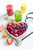 Fresh fruits vegetables and heart shape with stethoscope health diet concept. Closeup royalty free stock image