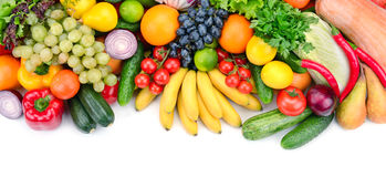 Fresh fruits and vegetables. Isolated on white background