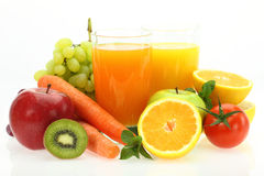 Fresh fruits, vegetables and juice. On white background royalty free stock photos