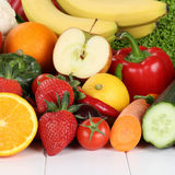 Fresh fruits and vegetables like oranges, apple, tomatoes Stock Photo