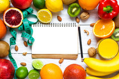 Fresh fruits and vegetables with nuts for healthy diet on white wooden table royalty free stock images