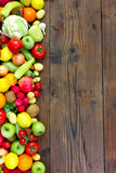Fresh fruits and vegetables. On the old wooden board Stock Photography