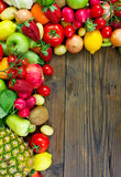 Fresh fruits and vegetables. On the old wooden board Stock Photo