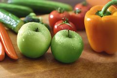 Fresh fruits and vegetables on the old wooden board stock photo
