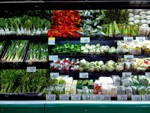 Fresh fruits and vegetables sold in a grocery store Stock Photo