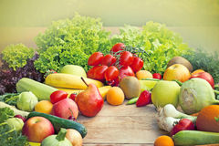 Fresh fruits and vegetables. Fruits and vegetables on a table royalty free stock images