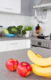 Fresh fruits and vegetables on table in the kitchen. Fresh fruits and vegetables on table stock photography