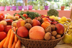 Fresh fruits and vegetables on a table Stock Photos