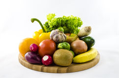 Fresh fruits and vegetables on wooden board. Stock Photography
