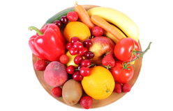 Fresh fruits and vegetables on wooden plate Royalty Free Stock Photo
