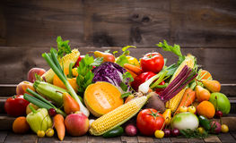 Fresh fruits and vegetables. On the wooden table stock photography