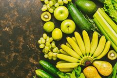 Fresh fruits and vegetables are yellow and green. Top view, copy space. stock photography