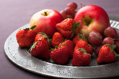 Fresh fruits on vintage plate Royalty Free Stock Photo