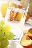 Fresh fruits and water. Fresh fruits and glass of water royalty free stock images