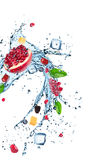 Fresh fruits in water splash. Isolated on white background stock photography