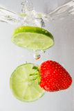 Fresh fruits with water splash isolated on white Stock Photos