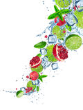Fresh fruits in water splash on white background. Fresh fruits in water splash, isolated on white background Stock Images