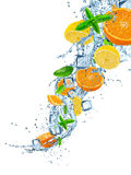 Fresh fruits in water splash on white background. Fresh fruits in water splash, isolated on white background Stock Photo