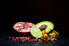 Fresh fruits with waterdrops on them Royalty Free Stock Photography