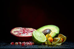 Fresh fruits with waterdrops on them and knife Stock Image
