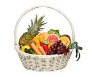 Fresh fruits and wegetables. Healthy food in basket isolated on white royalty free stock images