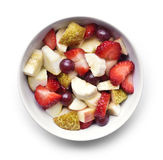 Fresh fruits in a white bowl, breakfast scene Royalty Free Stock Photography