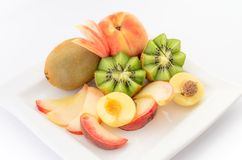 Fresh fruits  on a white plate close up Stock Image