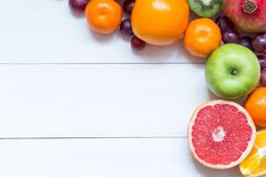 Fresh fruits on wooden boards frame background stock images