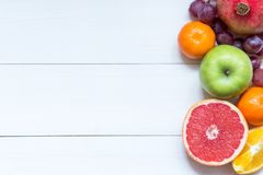 Fresh fruits on wooden boards frame background stock photo