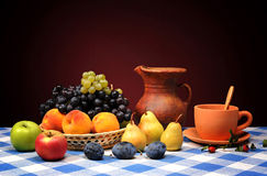 Fresh fruits in wicker baskets and pottery Royalty Free Stock Photos