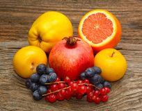 Fresh fruits on wooden background. Healthy eating, dieting, love fruits Stock Photos