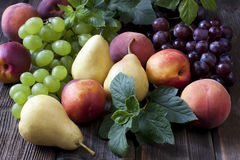 Fresh fruits on wooden board Royalty Free Stock Images