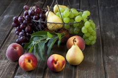 Fresh fruits on wooden board Royalty Free Stock Photography