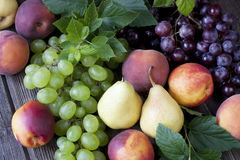 Fresh fruits on wooden board Royalty Free Stock Photos