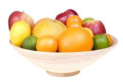 Fresh fruits on wooden bowl isolated Stock Image