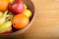 Fresh fruits on wooden table. Healthy eating concept Royalty Free Stock Photos