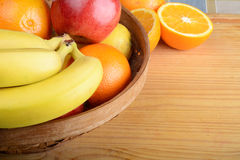 Fresh fruits on wooden table. Healthy eating concept Royalty Free Stock Image