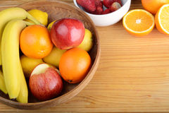 Fresh fruits on wooden table. Healthy eating concept Royalty Free Stock Photography