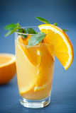 Fresh and fruity brew with oranges Stock Photography
