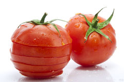 Fresh Full And Sliced Tomato Royalty Free Stock Photos