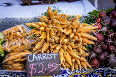 Fresh from the garden carrots for sale at local market Royalty Free Stock Image