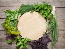 Fresh garden herbs and cutting board Royalty Free Stock Image