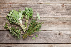 Fresh garden herbs on wooden table Stock Photo