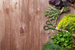Fresh garden herbs on wooden table Royalty Free Stock Photography