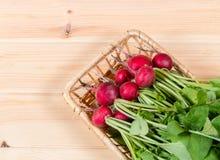 Fresh garden radish in wicker basket. Selective focus. Fresh raw garden radish in wicker basket. Selective focus Royalty Free Stock Photo