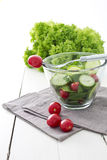 Fresh garden salad. With spinach, cucumber and tomato in a glass bowl stock photography