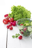 Fresh garden salad. With spinach, cucumber and tomato in a glass bowl stock photos