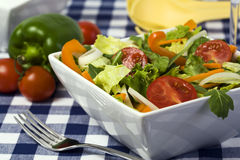 Fresh garden salad in square bowl Royalty Free Stock Image