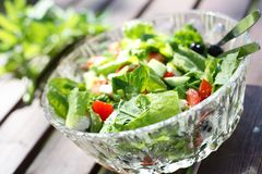 Fresh garden salad on a table. Stock Photo