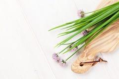 Fresh garden spring onion on white table Royalty Free Stock Photography